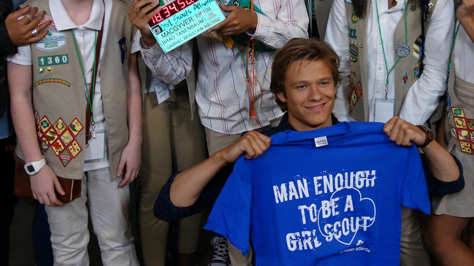 Lucas Till shows off a Girl Scouts T-shirt.
