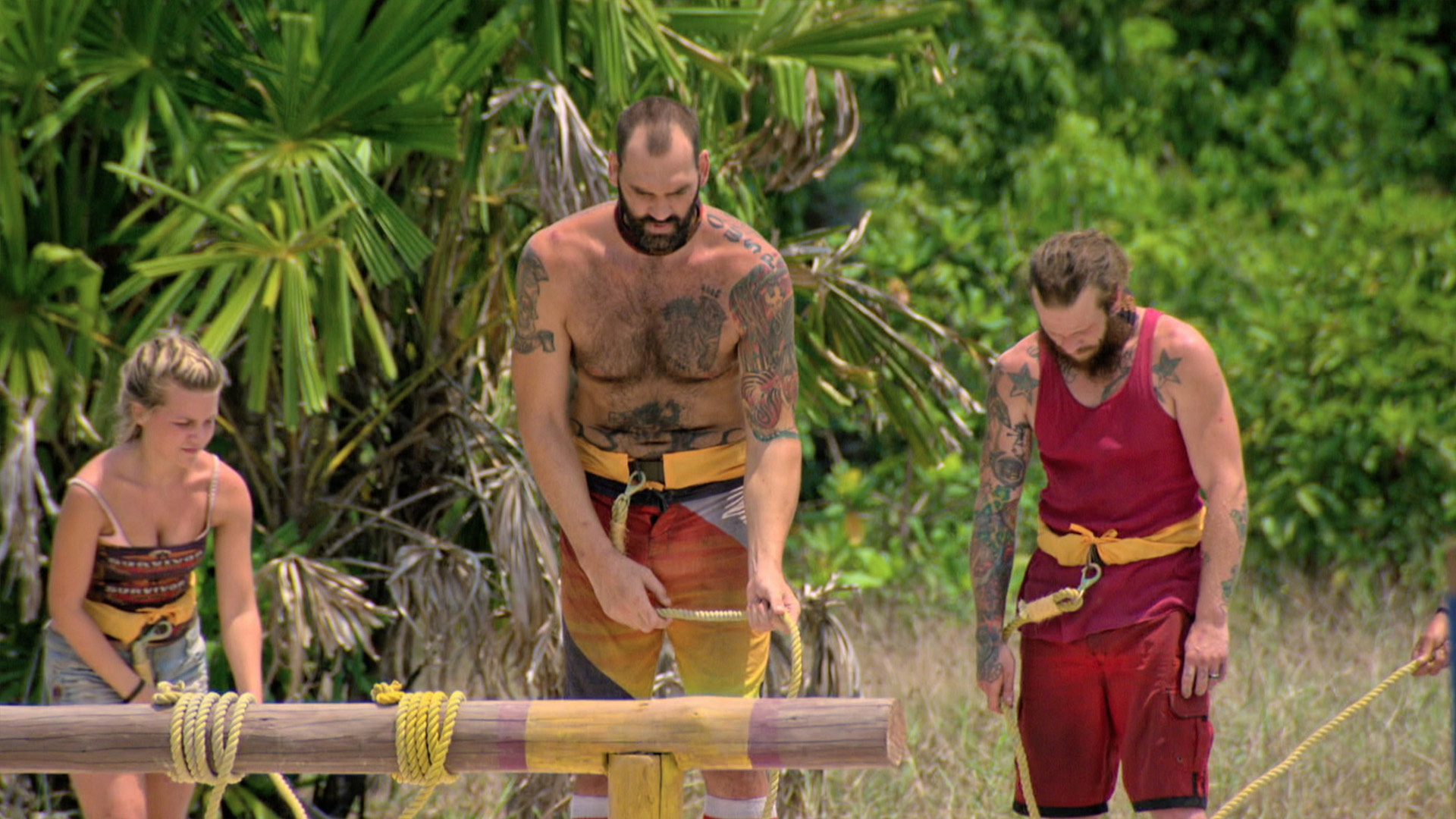 Julia, Scot, and Jason are tied together during the Reward Challenge.
