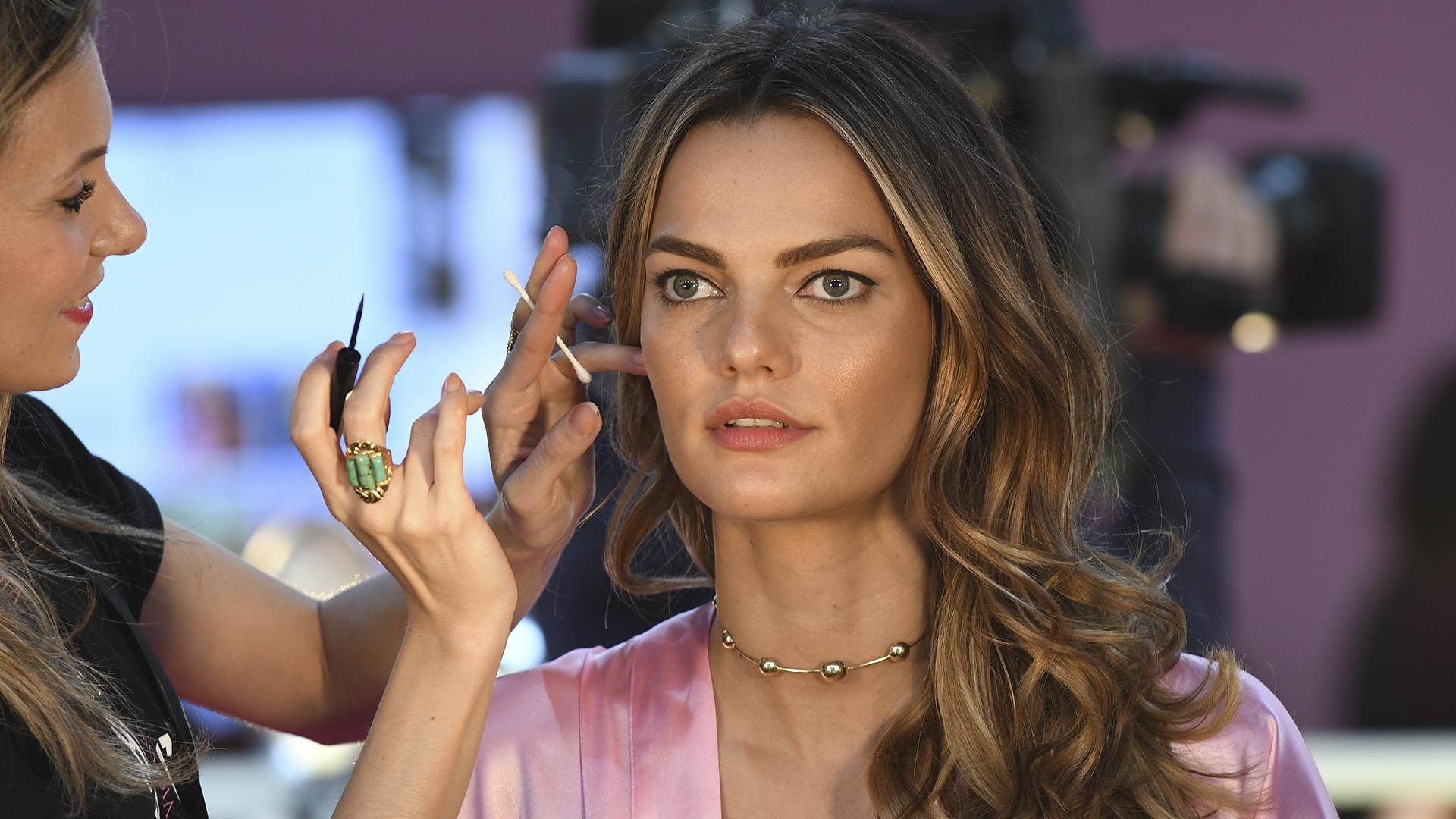 Brazilian model Barbara Fialho perfects her eyeliner.