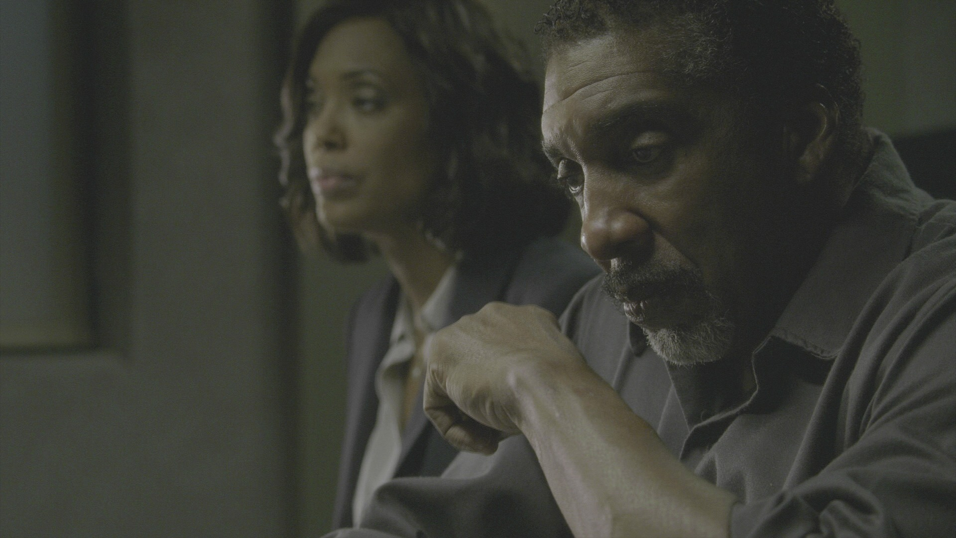 Dr. Lewis and her father sit in silence.
