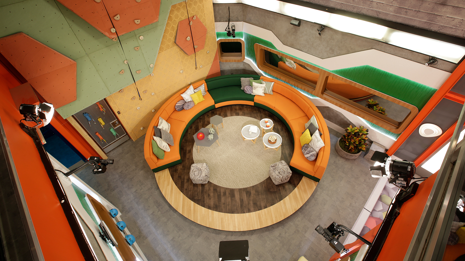 In another first, this season's circular couch is on a large rotating platform, opening up a space for the Houseguests to access the climbing wall.