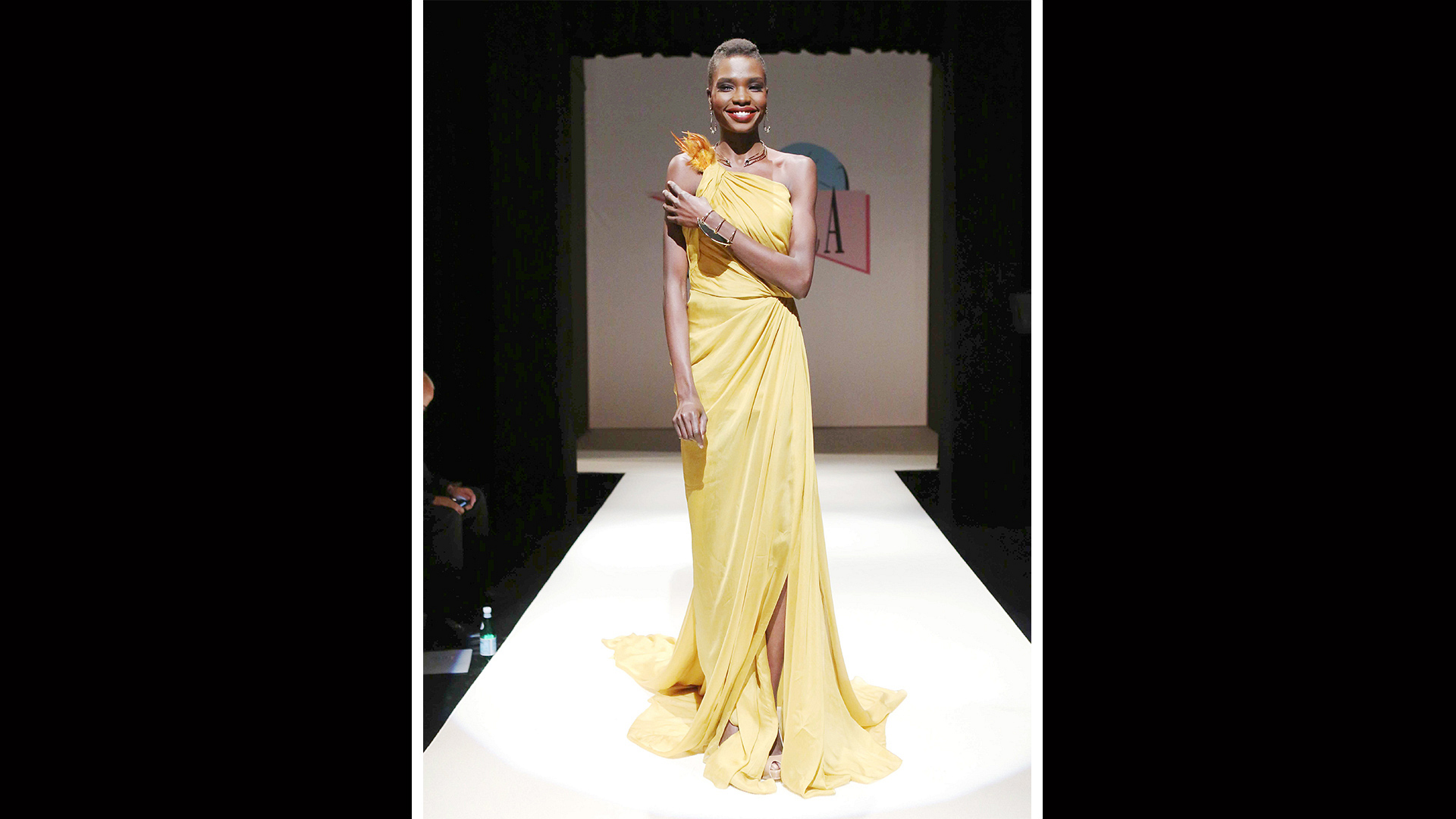 This off-the-shoulder yellow gown is perfect for cool spring nights.