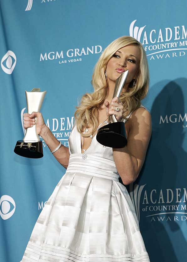 """Carrie Underwood matched her """"Entertainer Of The Year"""" and """"Triple Crown"""" statues on the red carpet at the 45th Annual Academy of Country Music Awards."""