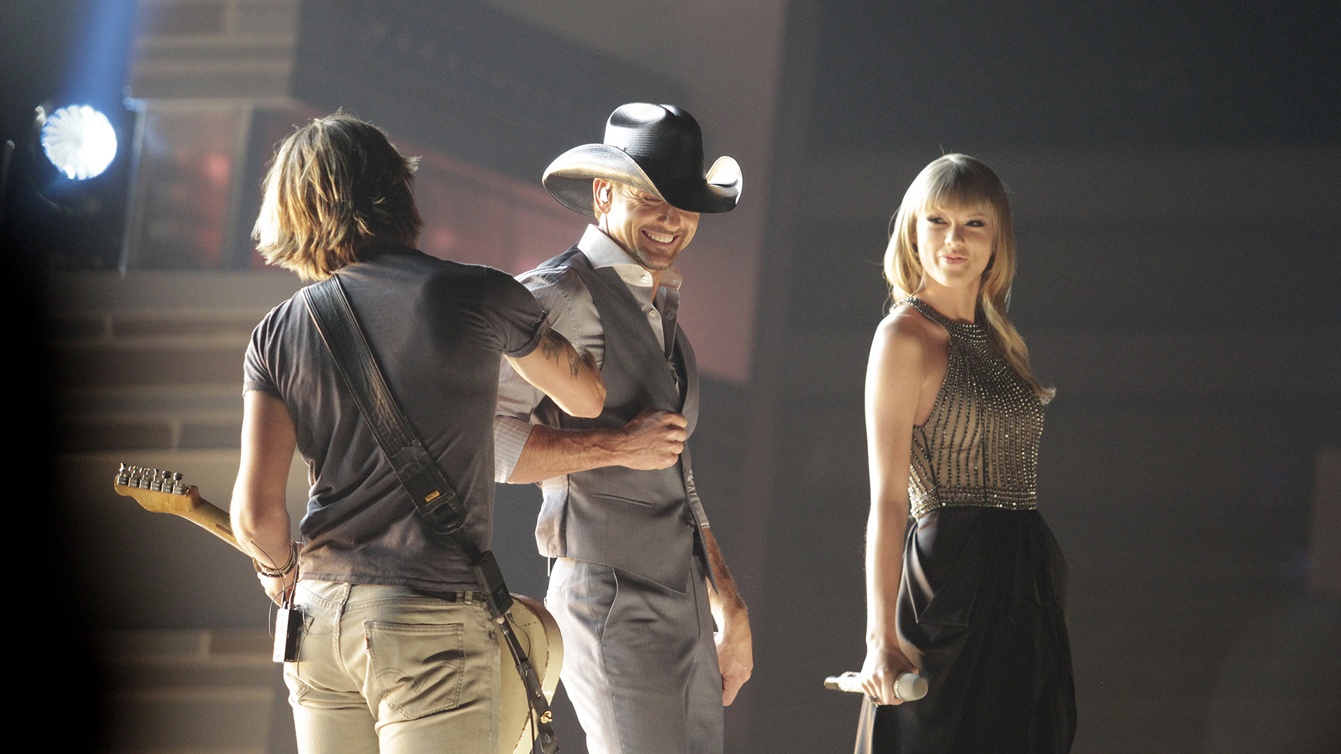 "26. Tim McGraw, Taylor Swift, and Keith Urban perform ""Highway Don't Care"" at the 48th ACM Awards in 2013."
