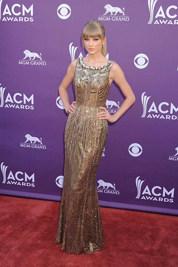 Taylor Swift glistened like  gold at the 48th Annual Academy of Country Music Awards.