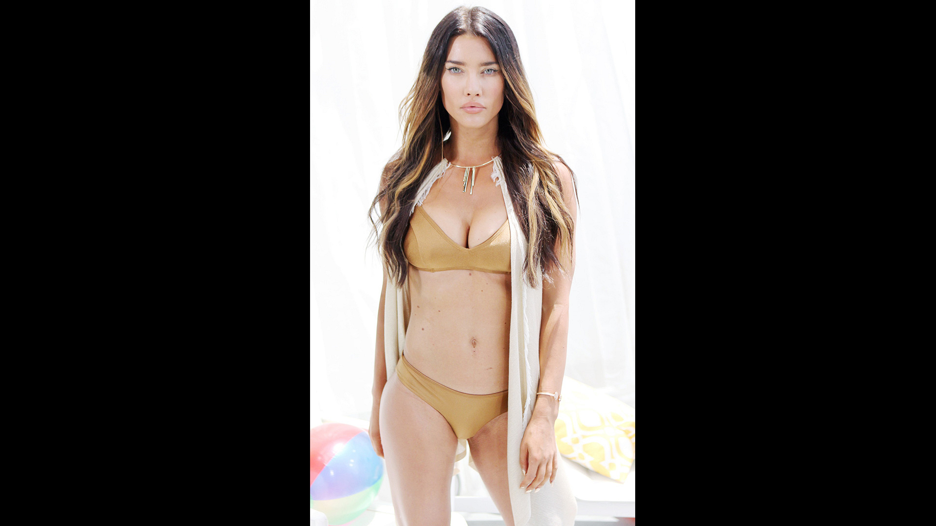 Jacqueline MacInnes Wood dons a neutral-colored two piece.