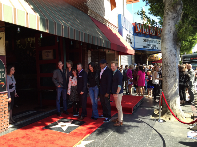 The cast of NCIS: LA poses with Chris O'Donnell