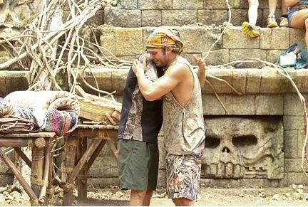 2. The Bromance Hug-Flex and Shoulder Pat