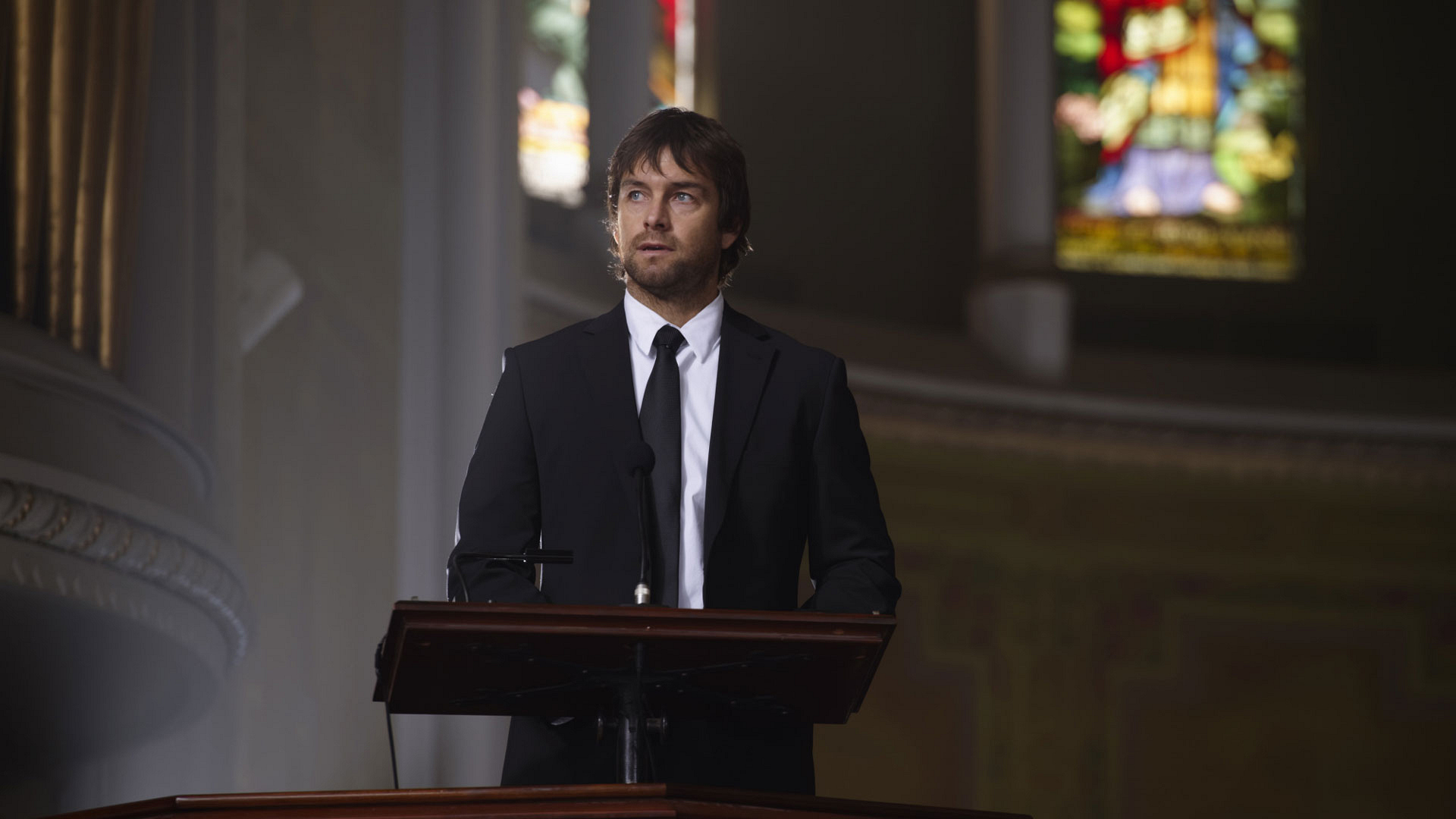 Garrett speaks at his father's funeral.