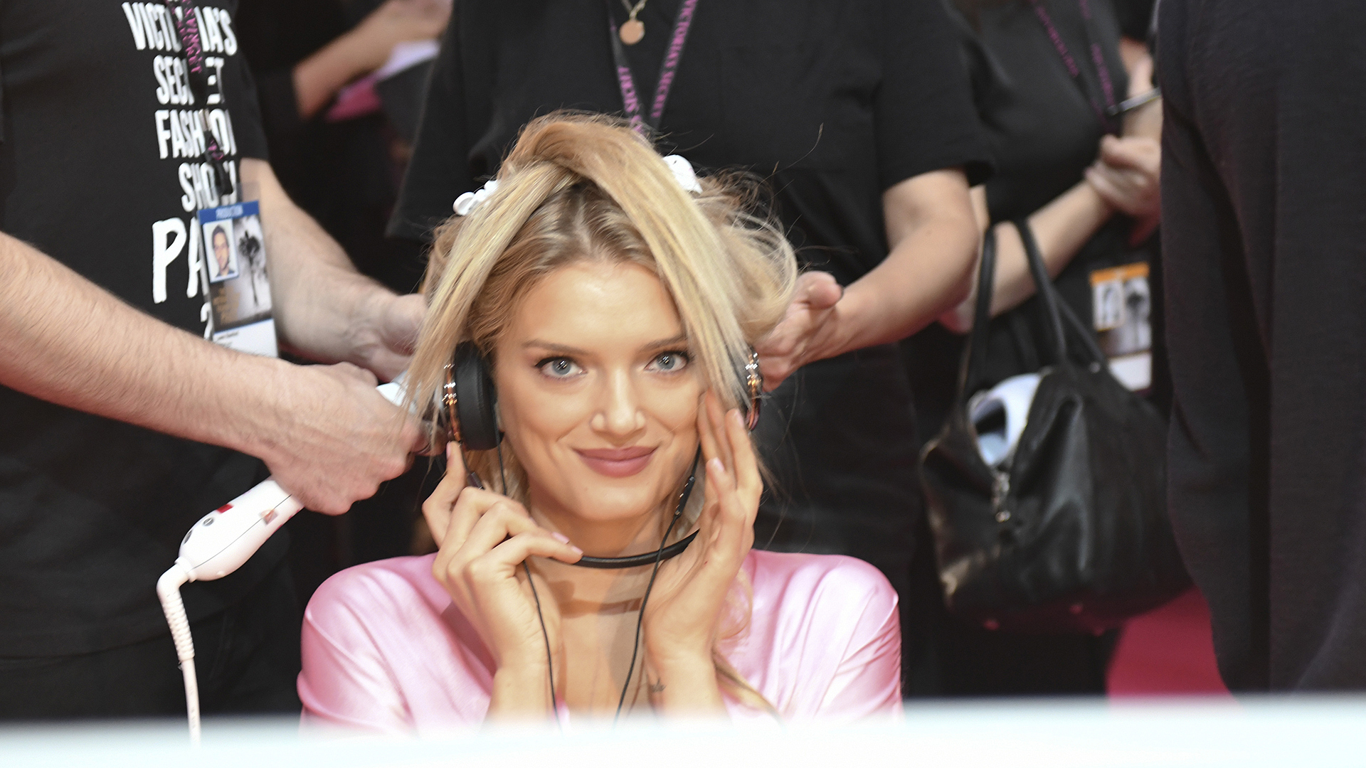 Lily Donaldson gets amped up with some tunes before curtain call.