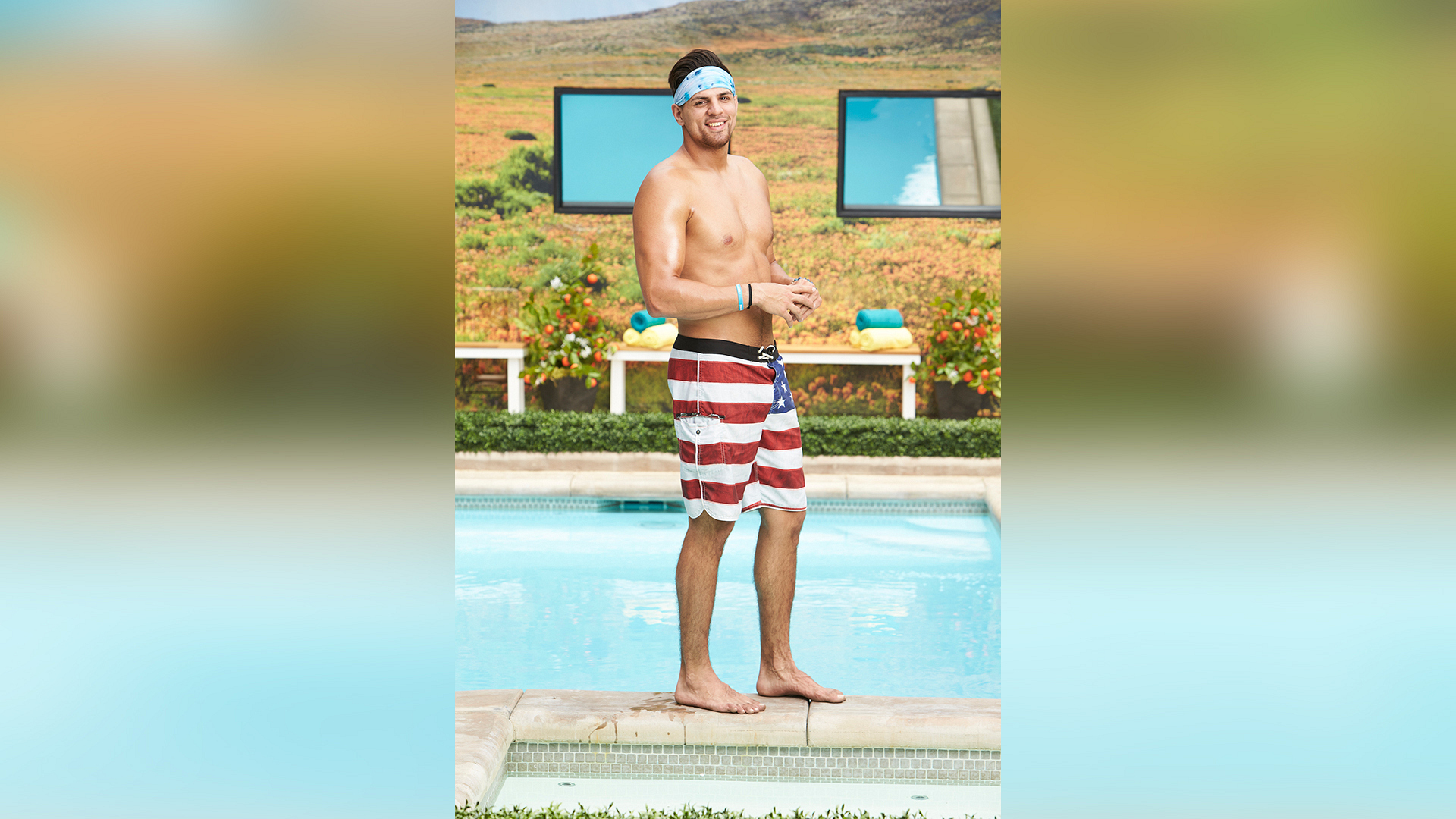 Faysal Shafaat rocks the red, white, and blue swim trunks.