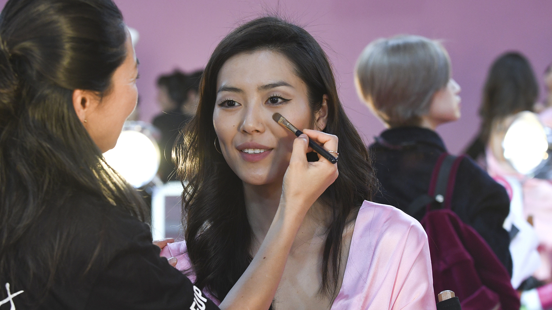 Liu Wen gets some last minute touch-ups.