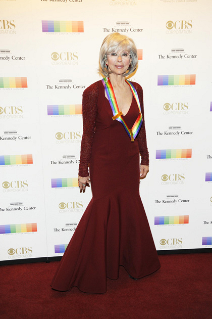 Actress/singer Rita Moreno looks riveting as she walks the red carpet.