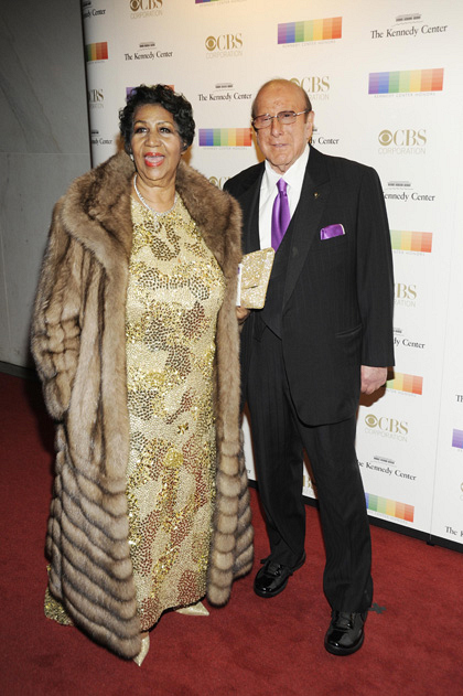 Music legend Aretha Franklin walks down the red carpet with renowned producer Clive Davis.