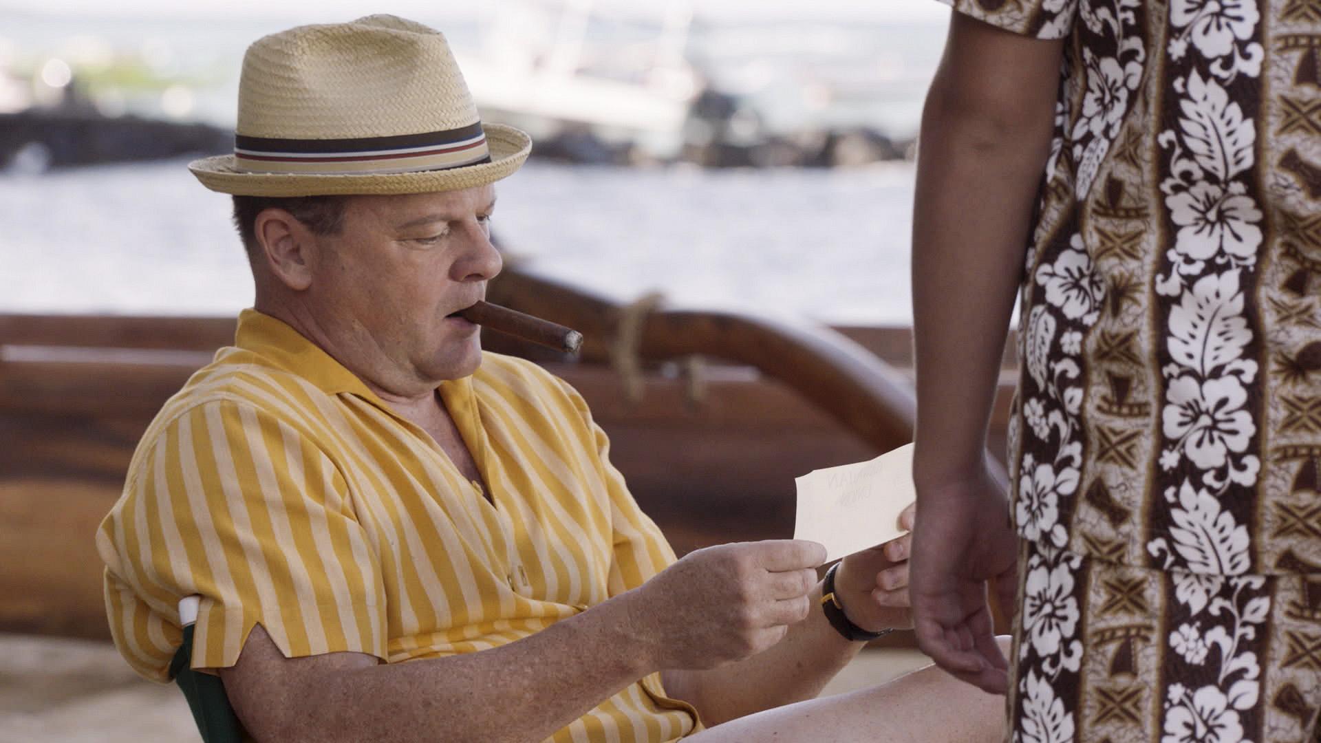 Dean Rusk chomps on a cigar.