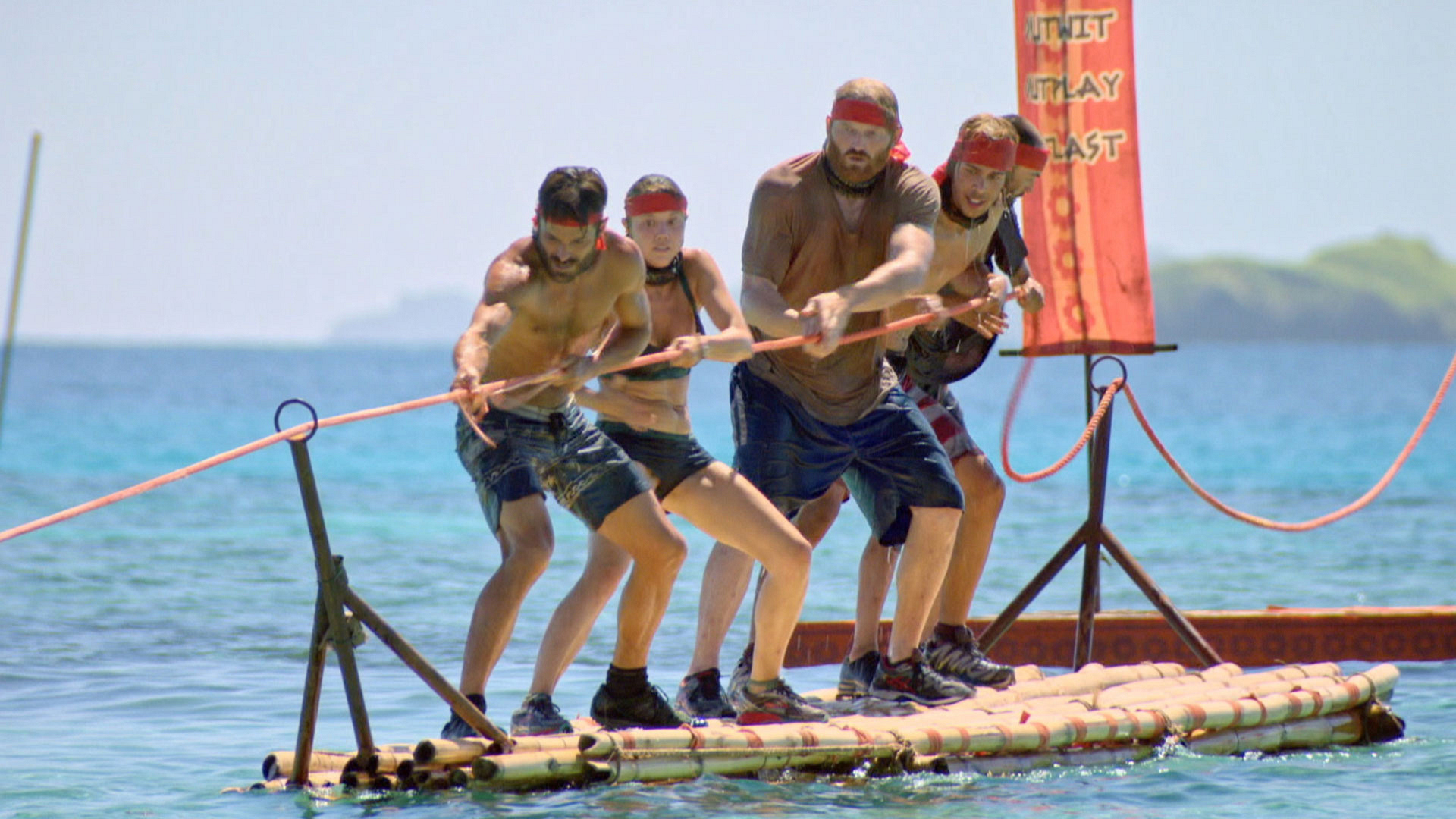 Ken leads the way for his team as they tug the rope.