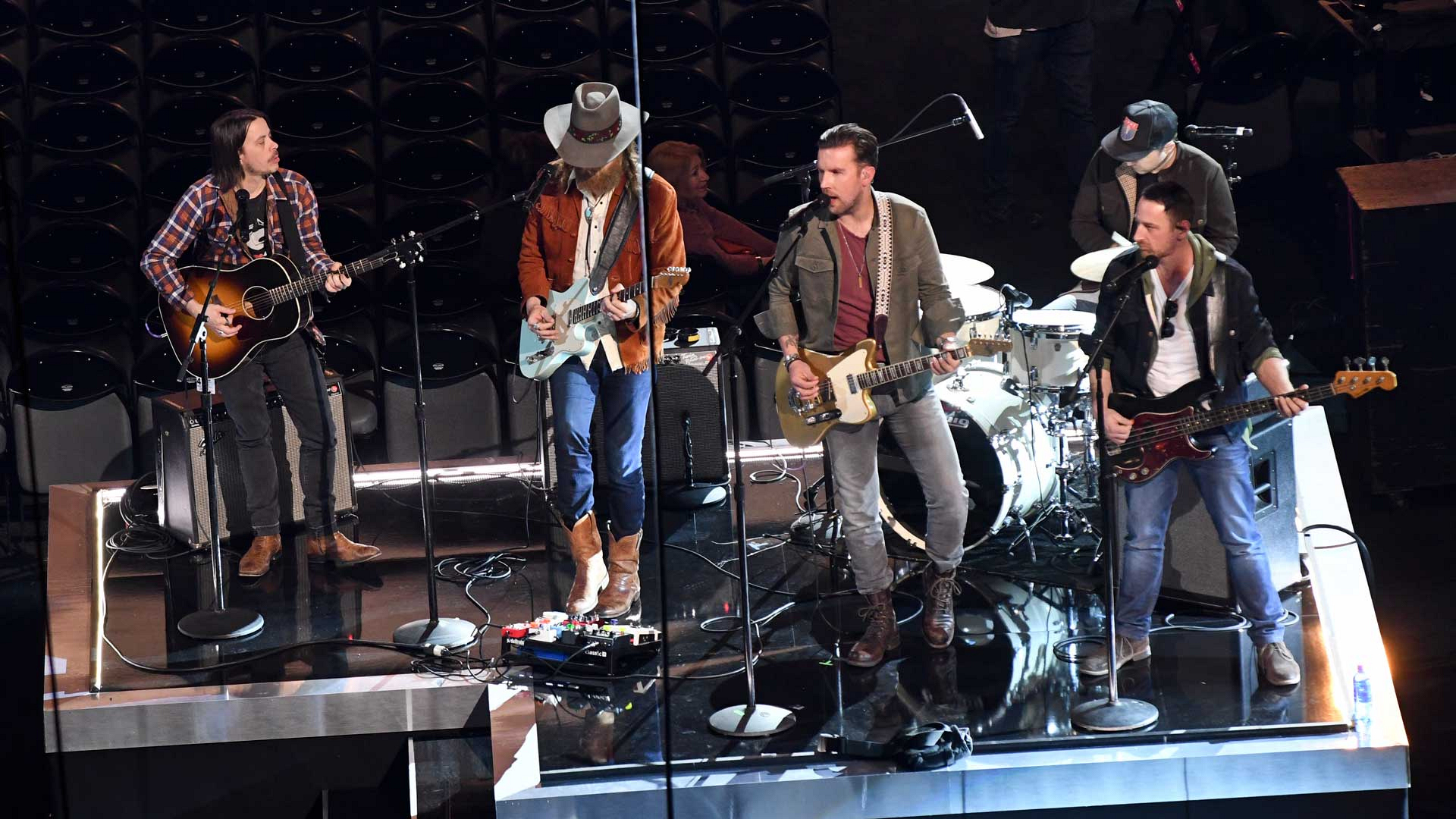 Brothers Osborne check their levels while rehearsing for the 52nd ACM Awards.