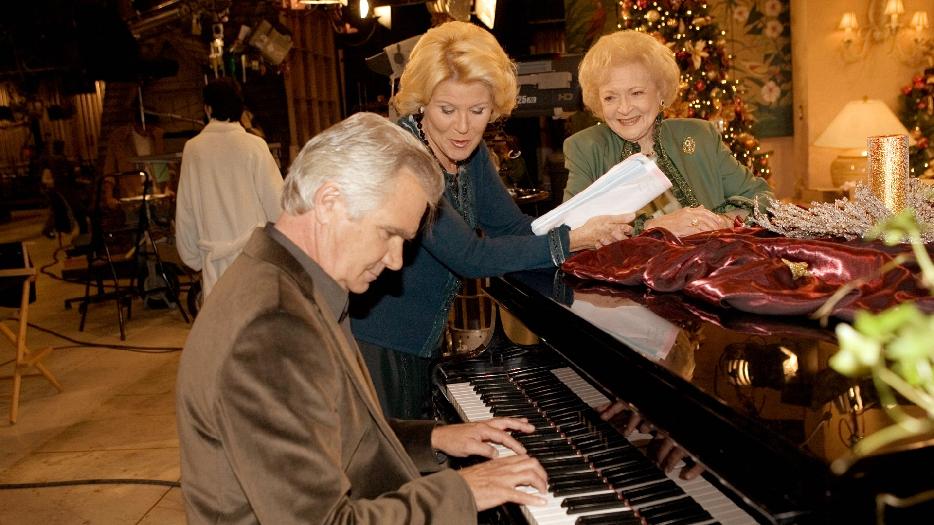 John McCook, Alley Mills, and Betty White sing a song between scenes.