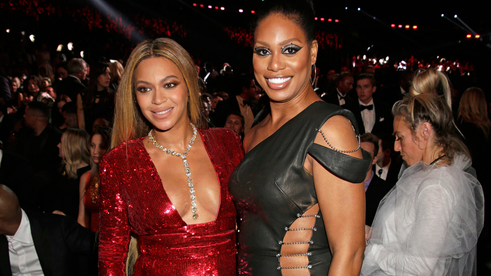 Beyoncé and actress Laverne Cox reveal lots of skin while posing together during a GRAMMY commercial break.