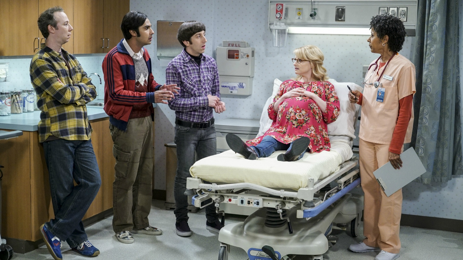 The guys take turns sharing information about Bernie's pregnancy with the nurse.