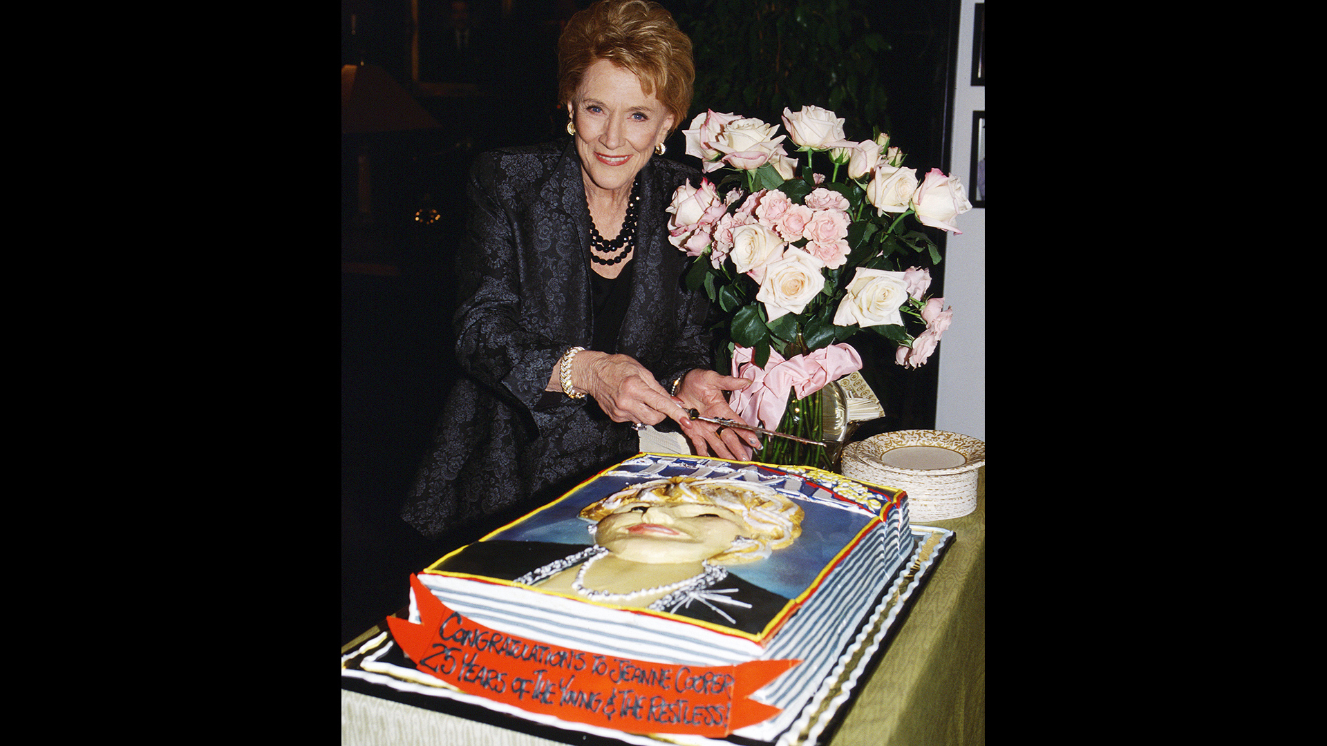 Jeanne Cooper cuts the cake as she achieves 25 years on Y&R.