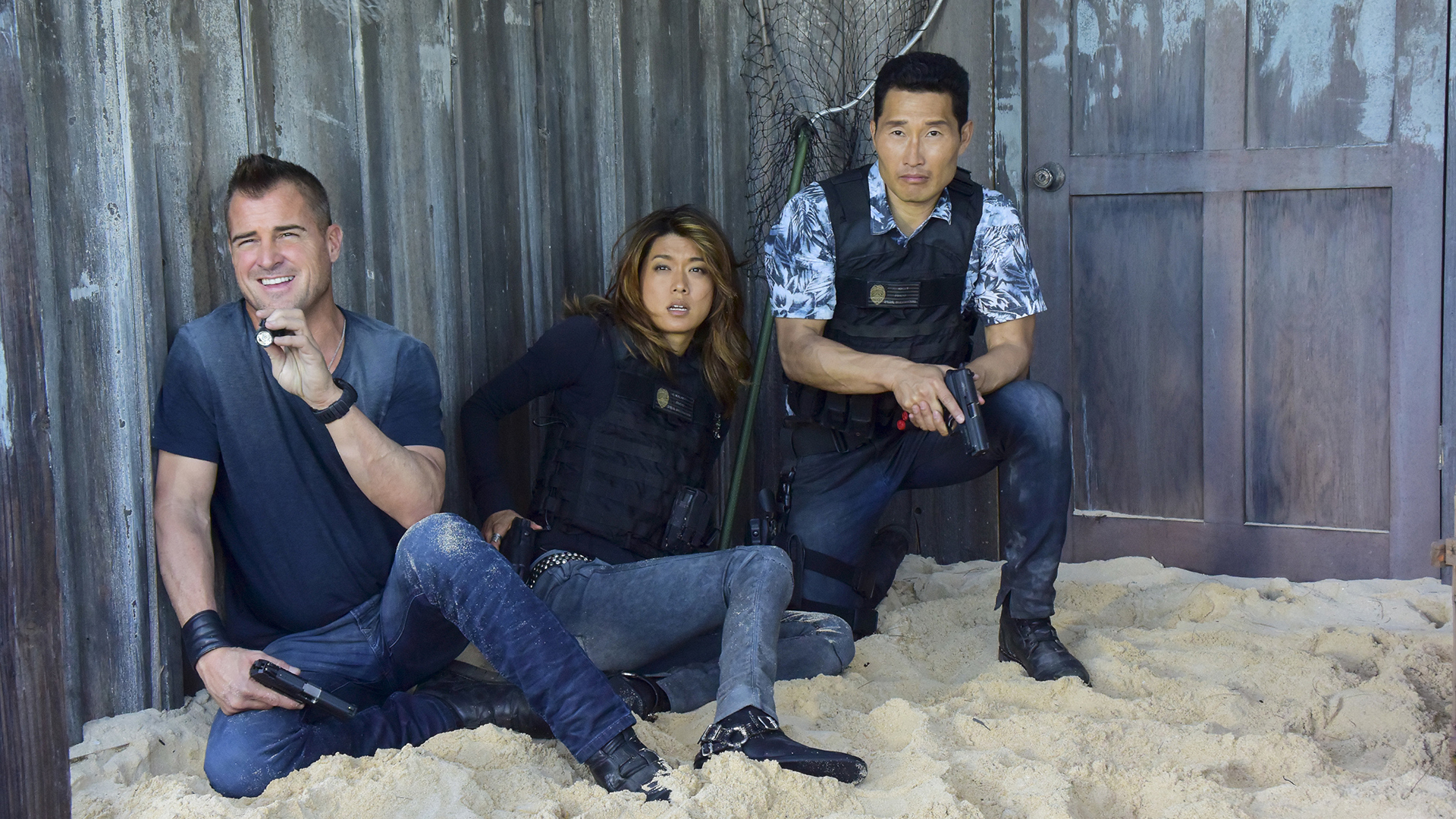 Jack, Kono, and Chin use a wall for cover.