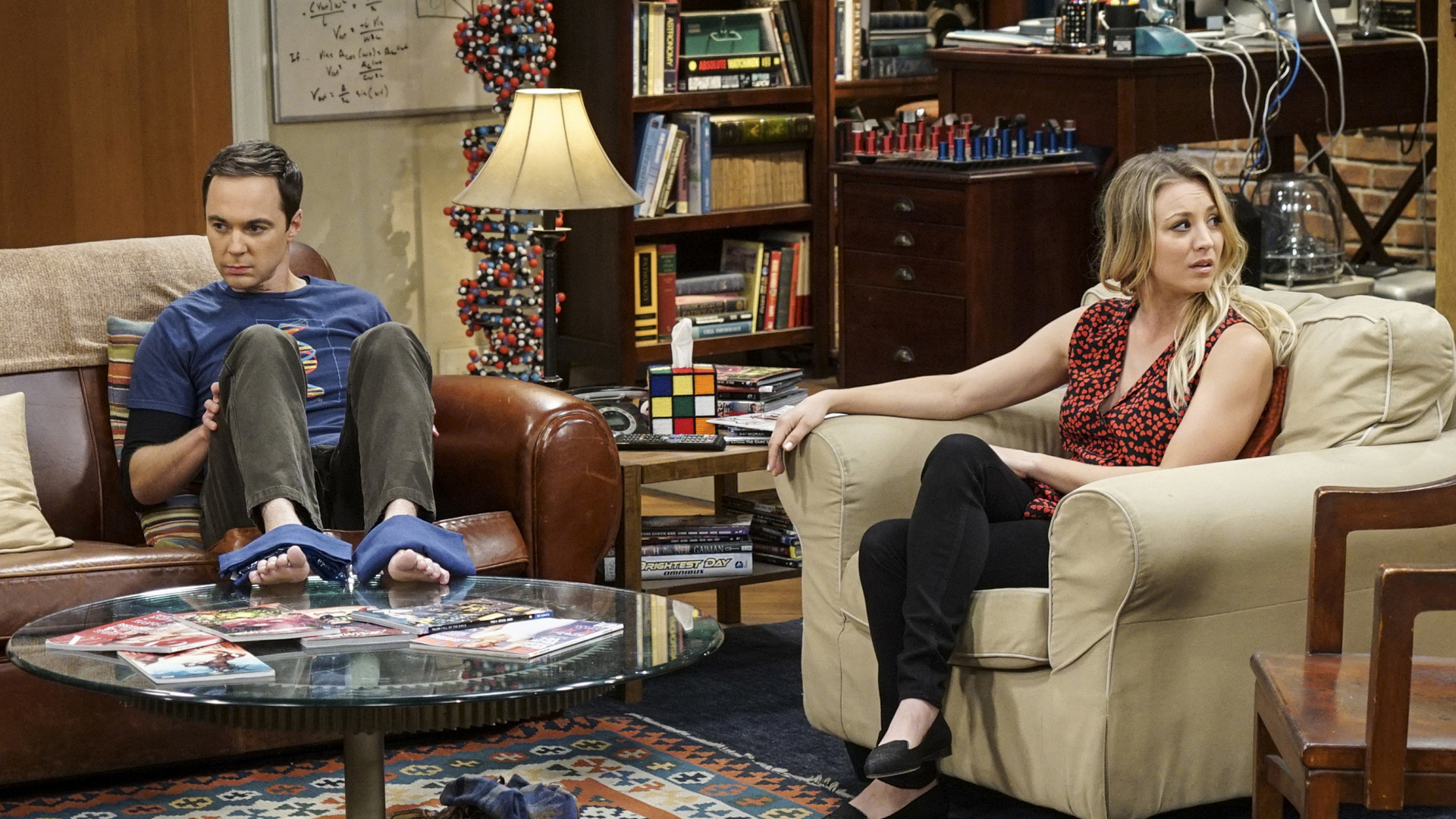 Penny reluctantly tries to console Sheldon.