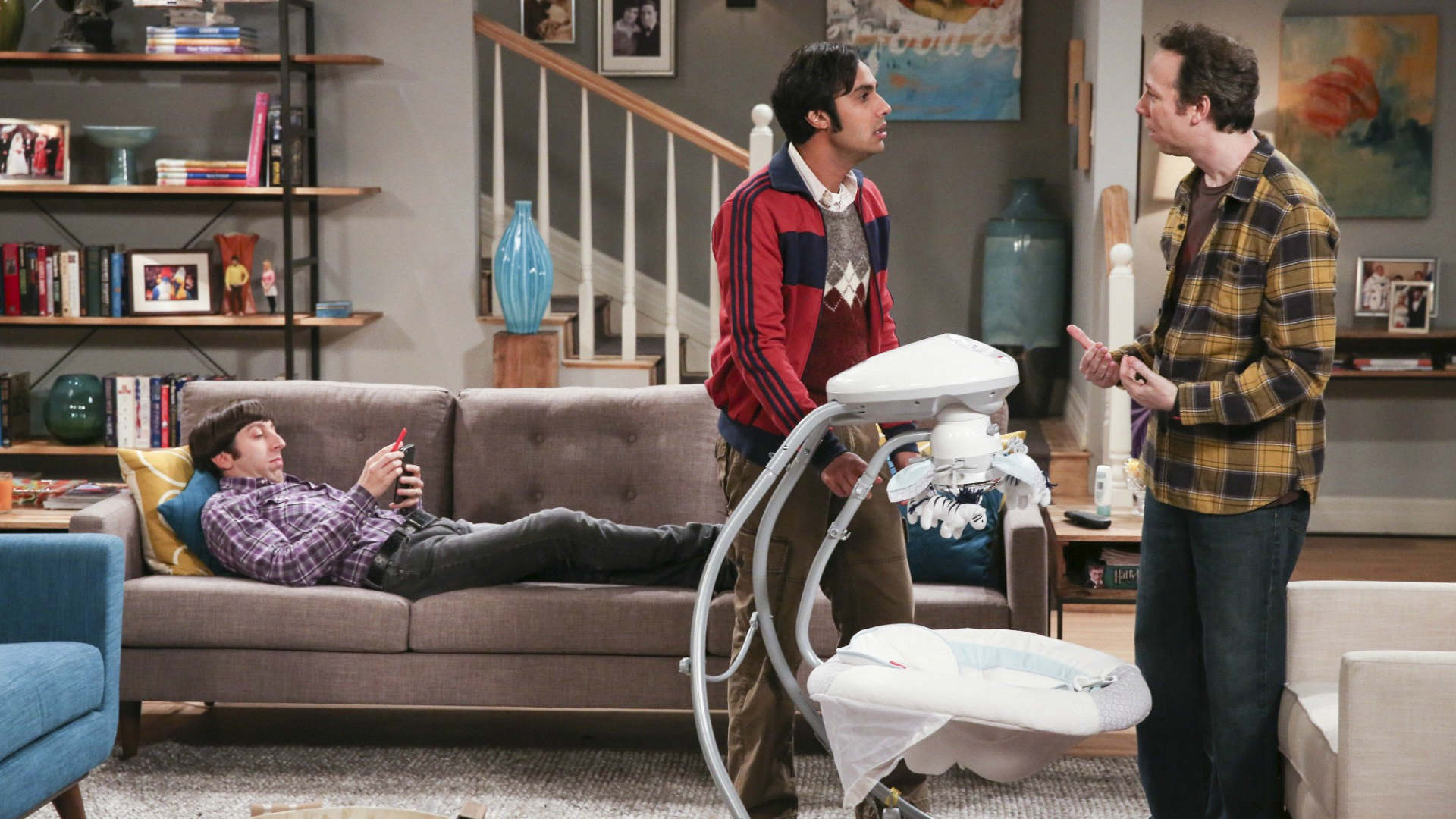 Howard kicks back as Raj and Stuart argue over baby-related responsibilities.