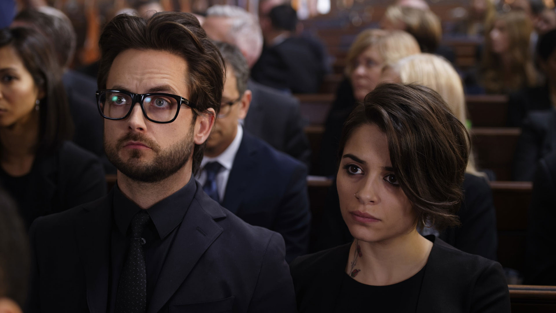 Cam and Sophie attend the funeral together.