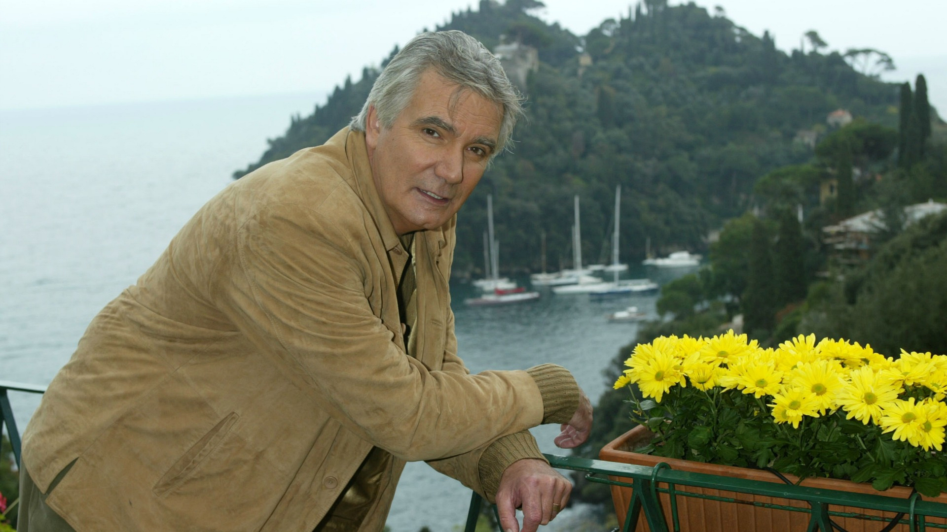 John McCook stopped to smell the flowers in Portofino, Italy.