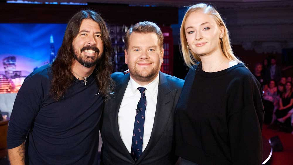 Dave Grohl, James Corden, and Sophie Turner pose for a group shot.