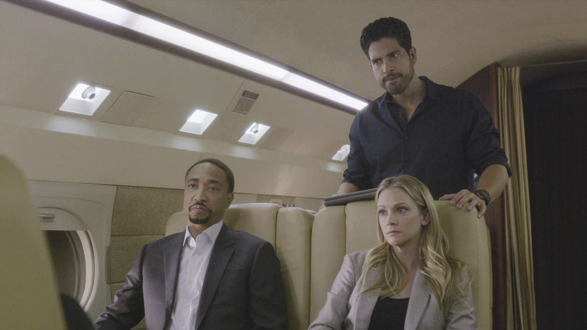 Agent Walker, JJ, and Agent Alvez explore ideas on the jet.
