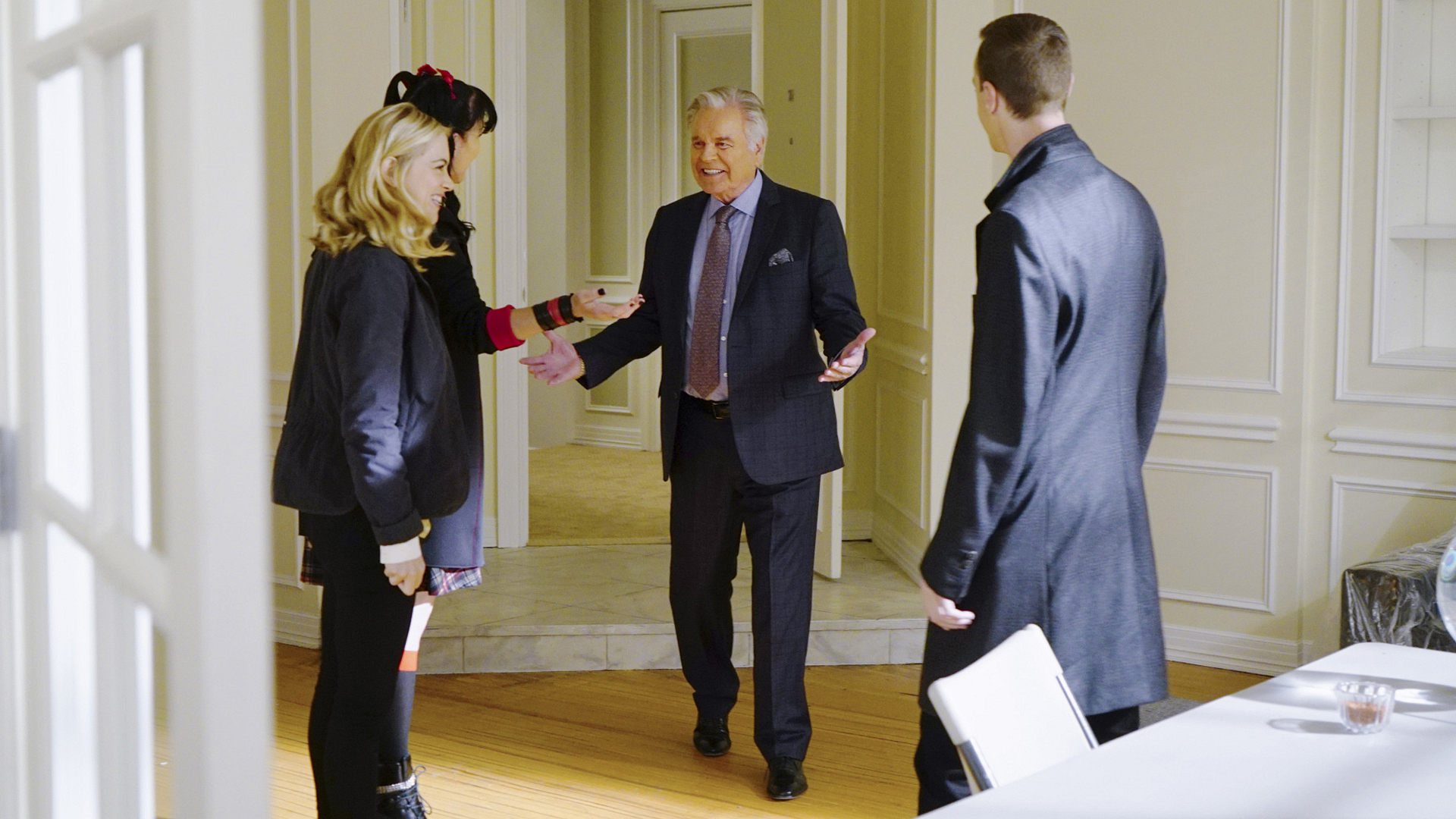 Anthony DiNozzo, Sr. greets Bishop, Abby, and McGee.