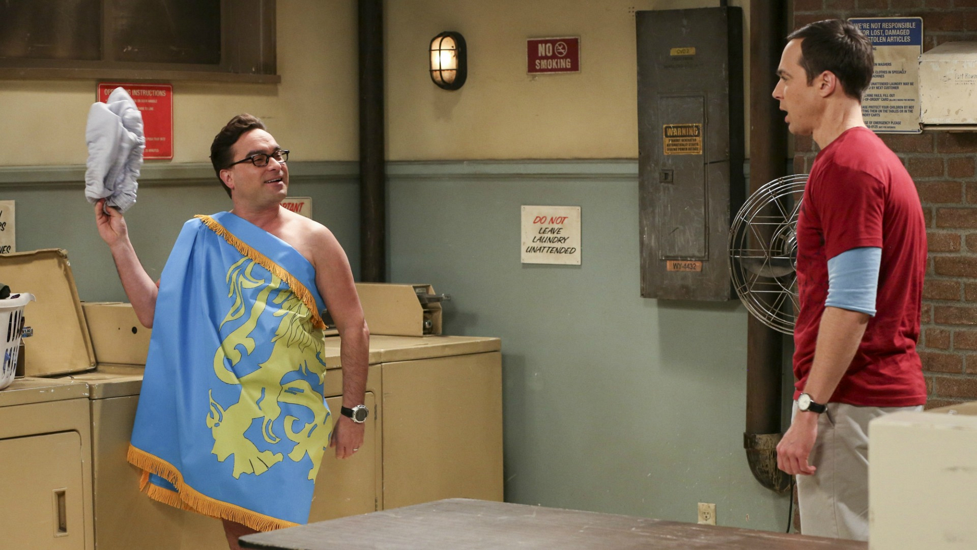 Sheldon is appalled to see Leonard wearing the apartment flag.