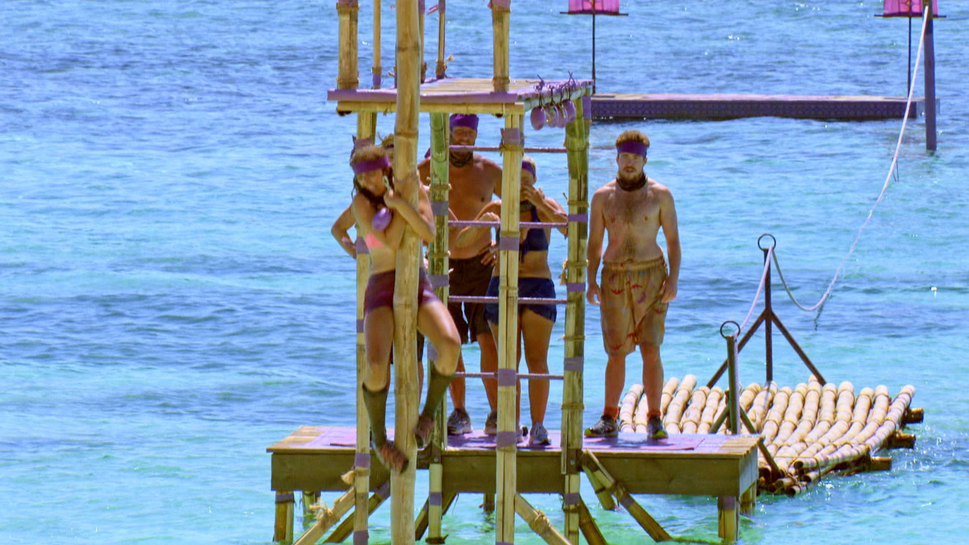 Hannah takes a trip down the pole.