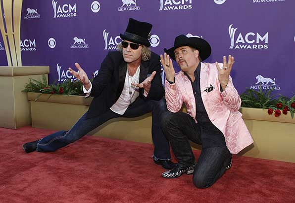 Big Kenny and John Rich from Big & Rich strike a curious pose on the red carpet at the 47th annual Academy of Country Music Awards.