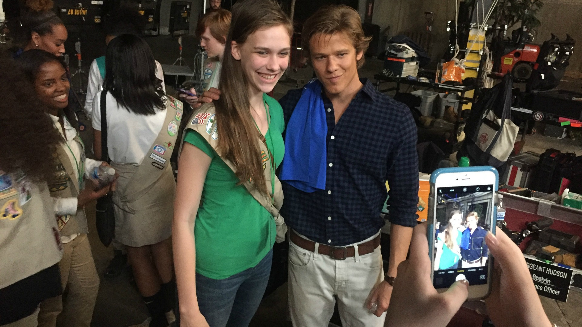 Lucas Till poses with a very excited Scout on the set of MacGyver.