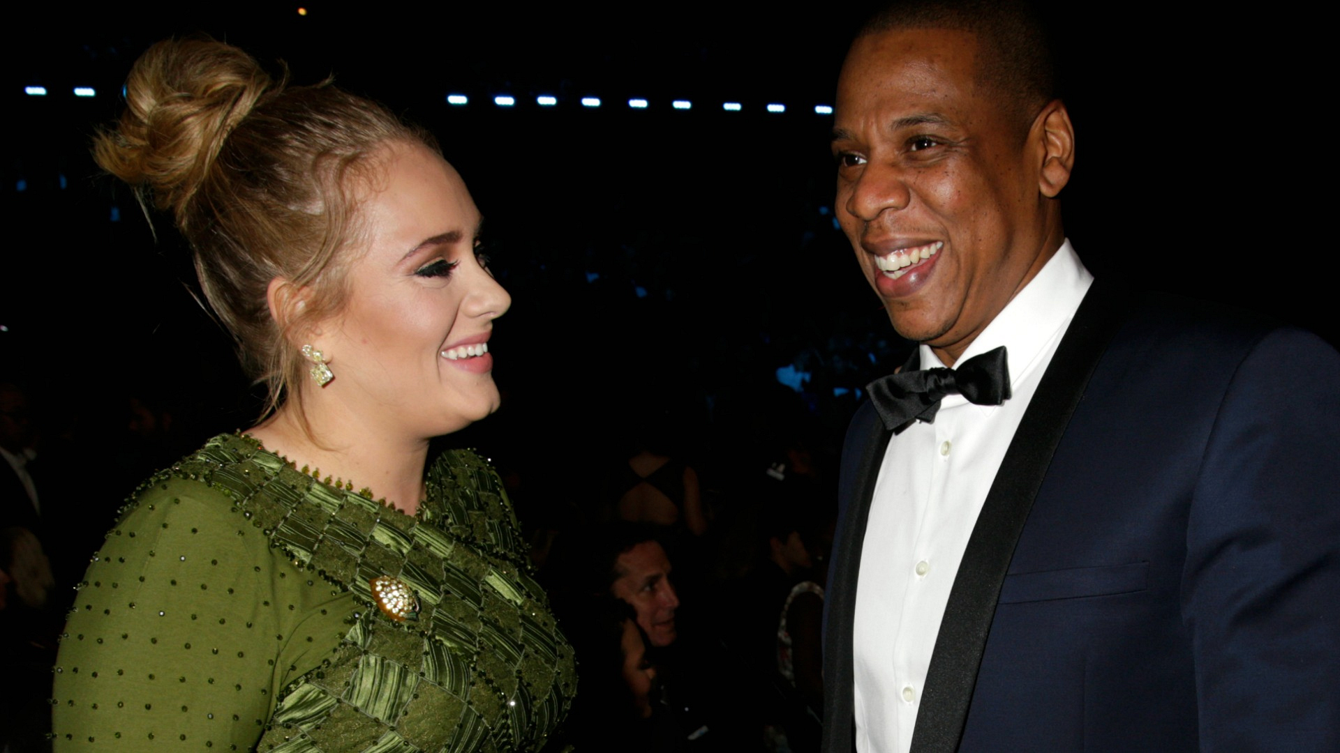 We wish we knew what Adele and Jay Z were giggling about.
