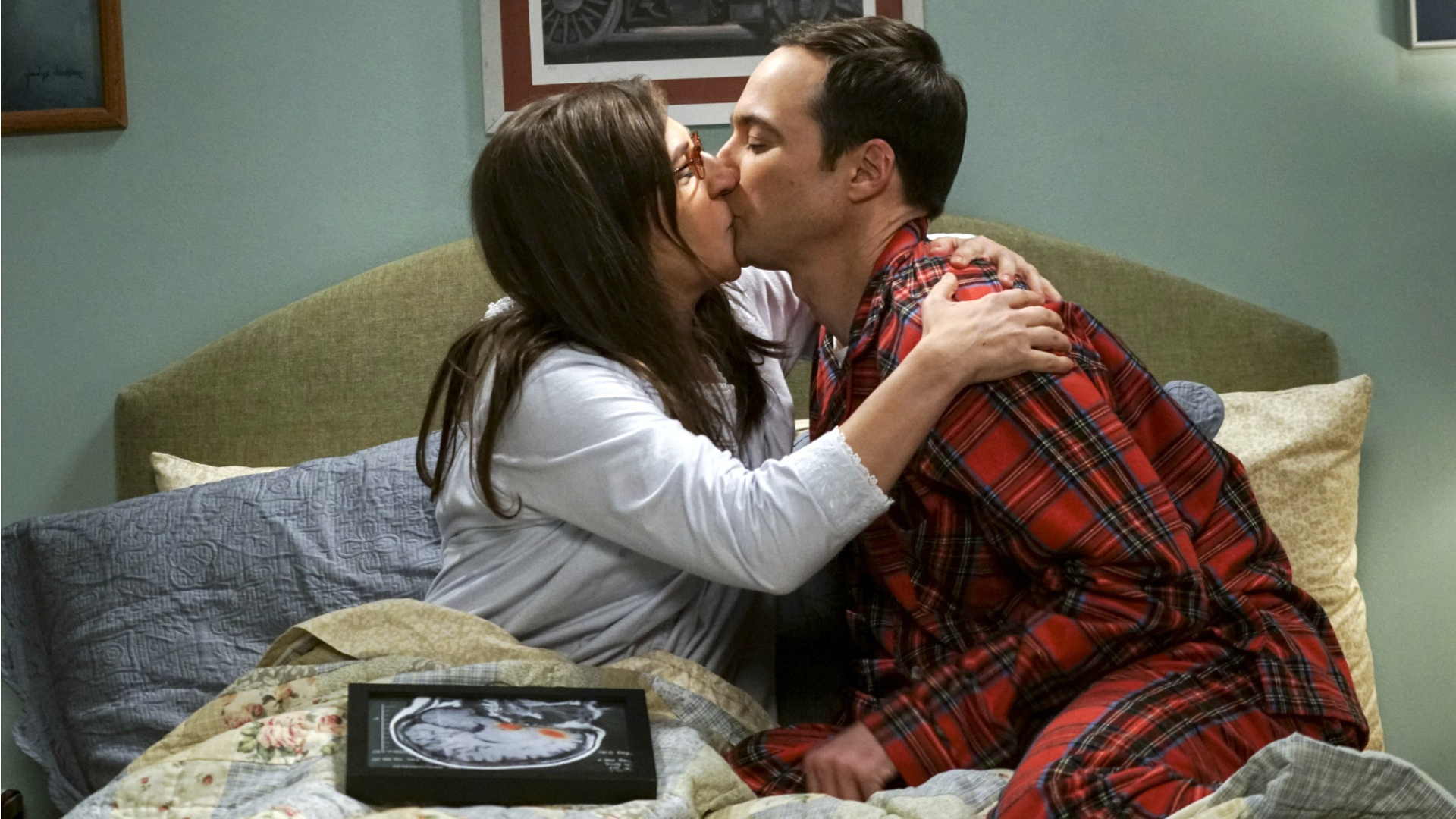 Amy pulls Sheldon in for a steamy smooch.