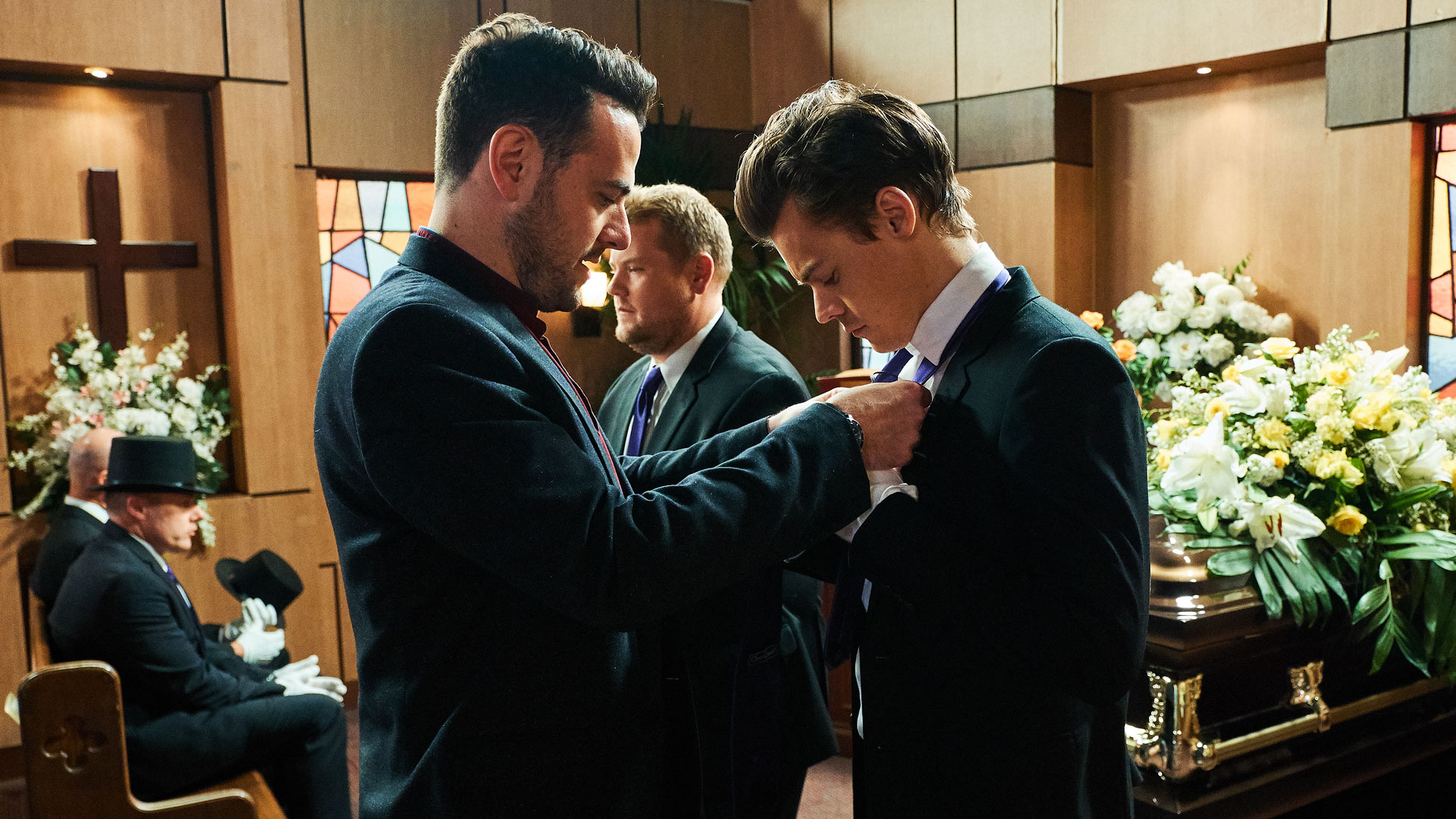 Straightening of the tie by Executive Producer Ben Winston