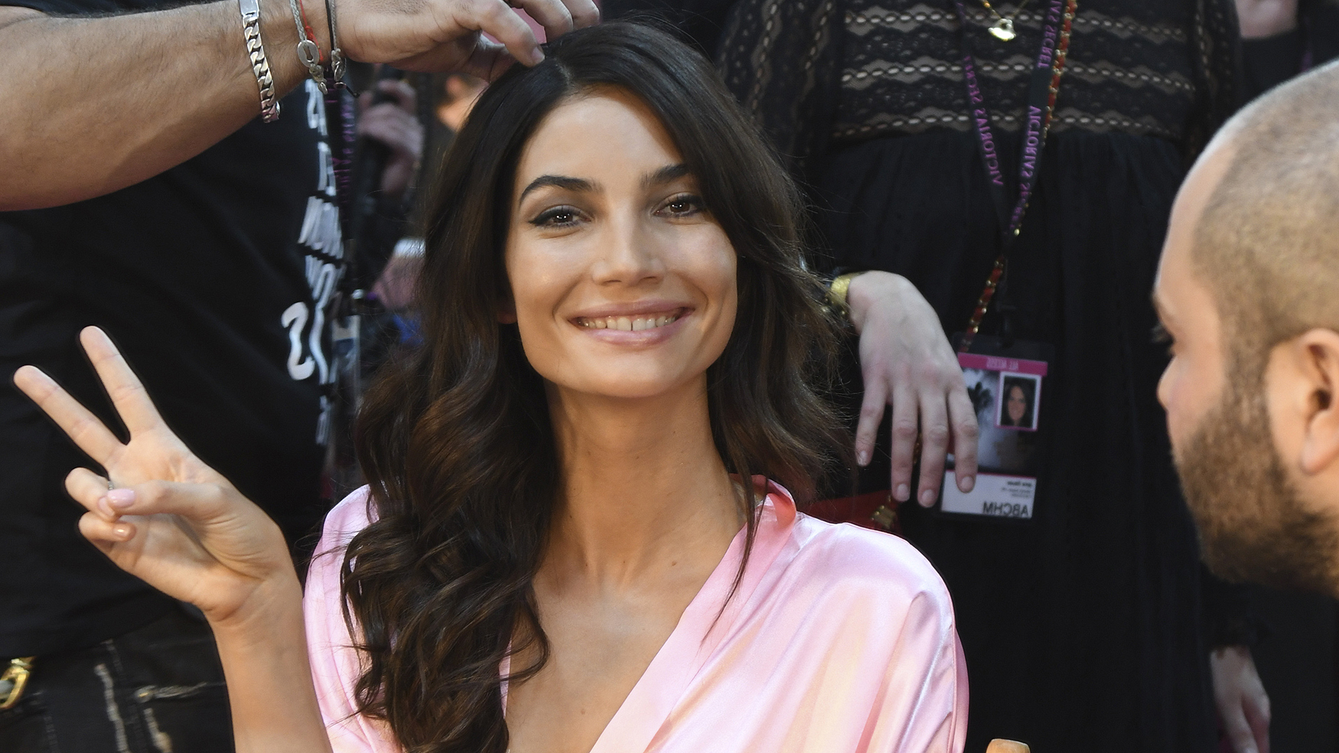 A hairstylist puts finishing touches on Angel Lily Aldridge.