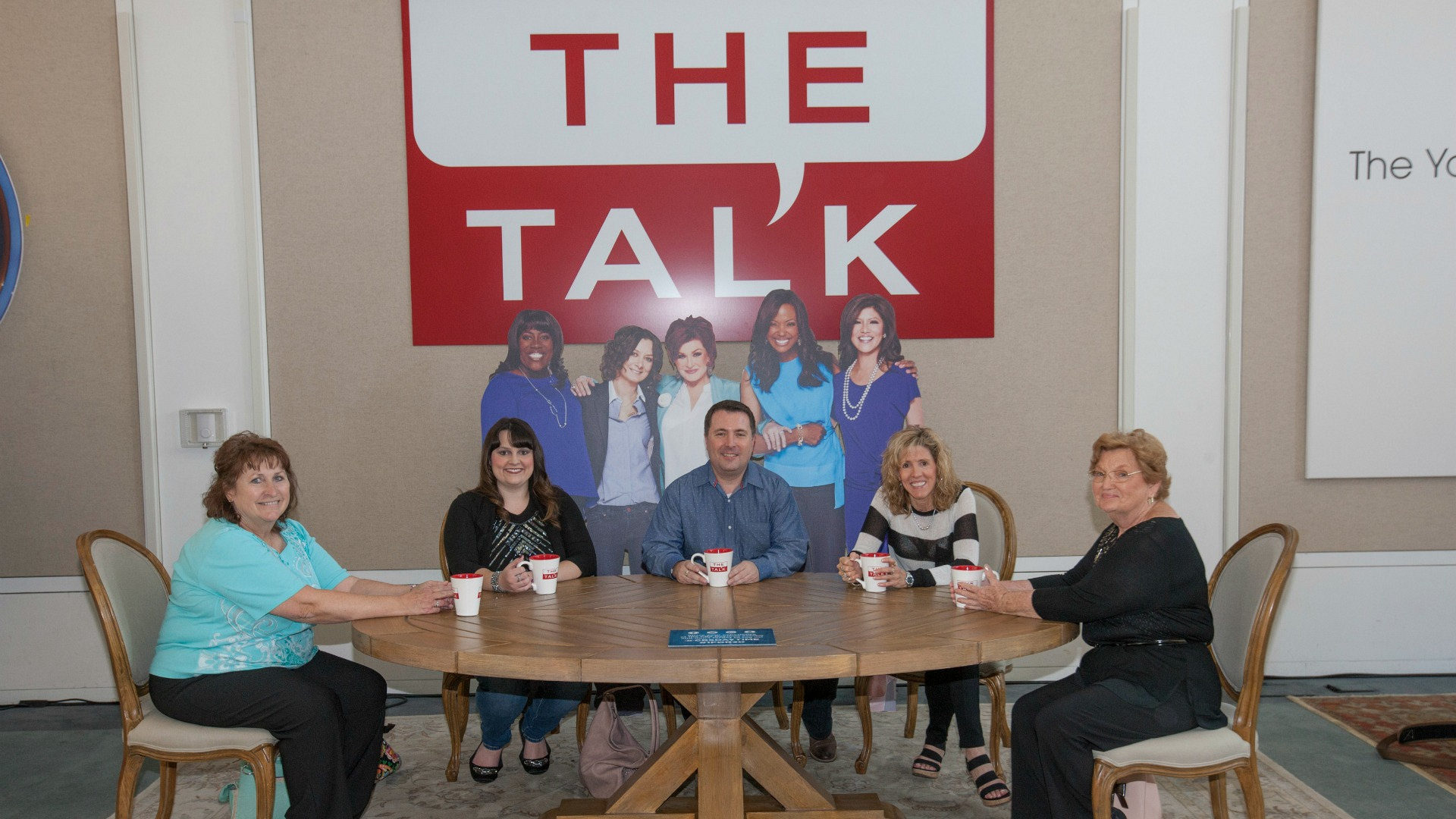 Five fans take a seat at The Talk table.