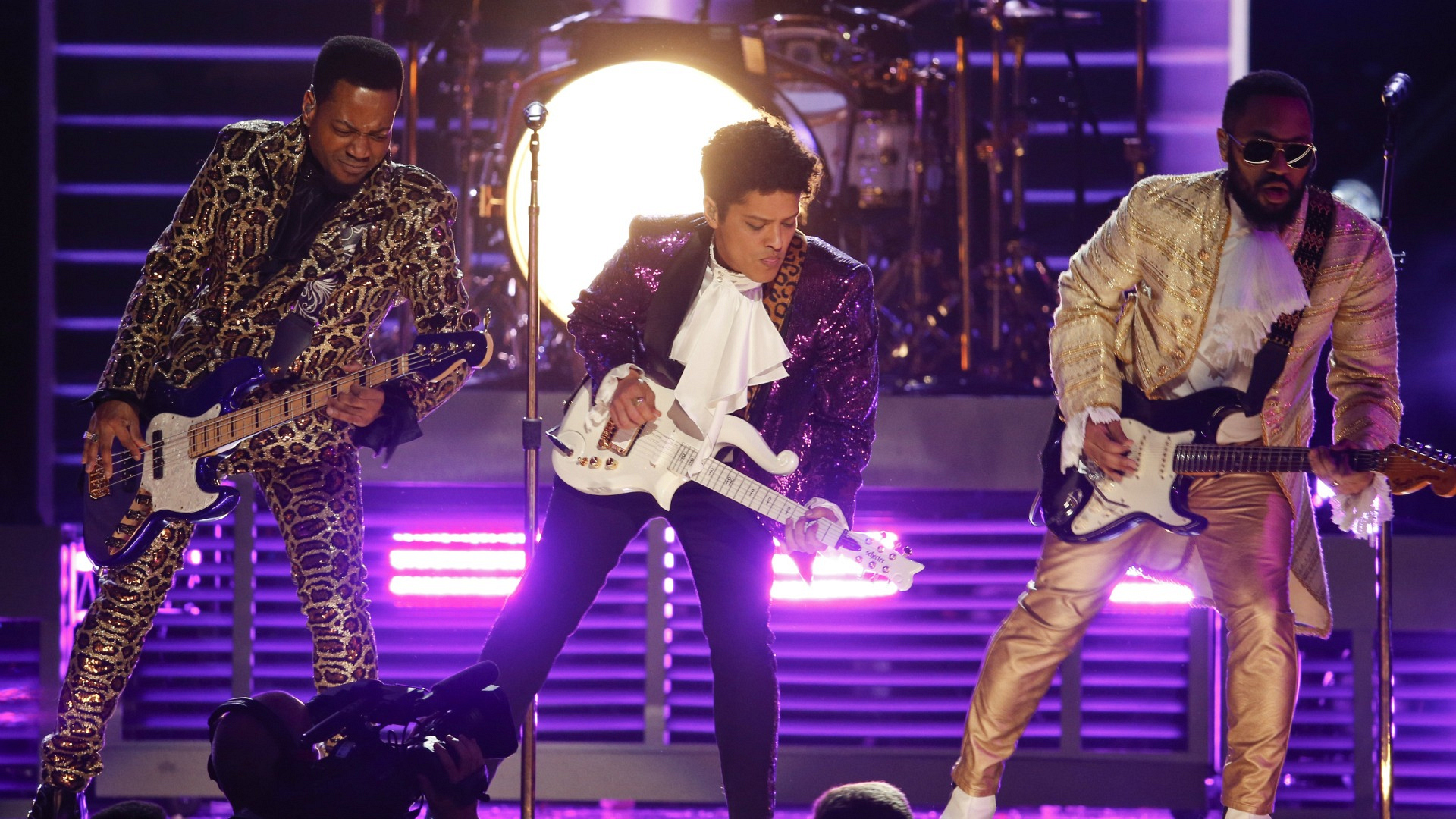 "Bruno Mars donned a purple suit during his performance of ""Let's Go Crazy"" as a tribute to Prince."