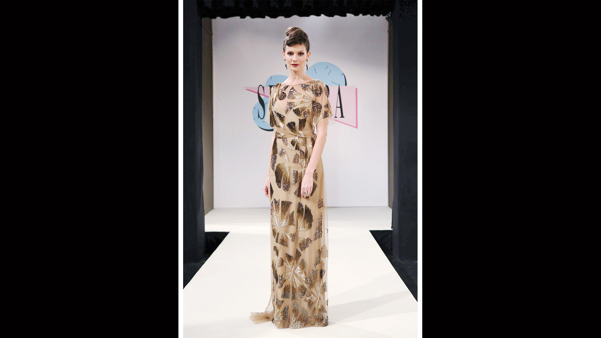 Gold beading and delicate fringe give this floor-length dress an art-deco feel.
