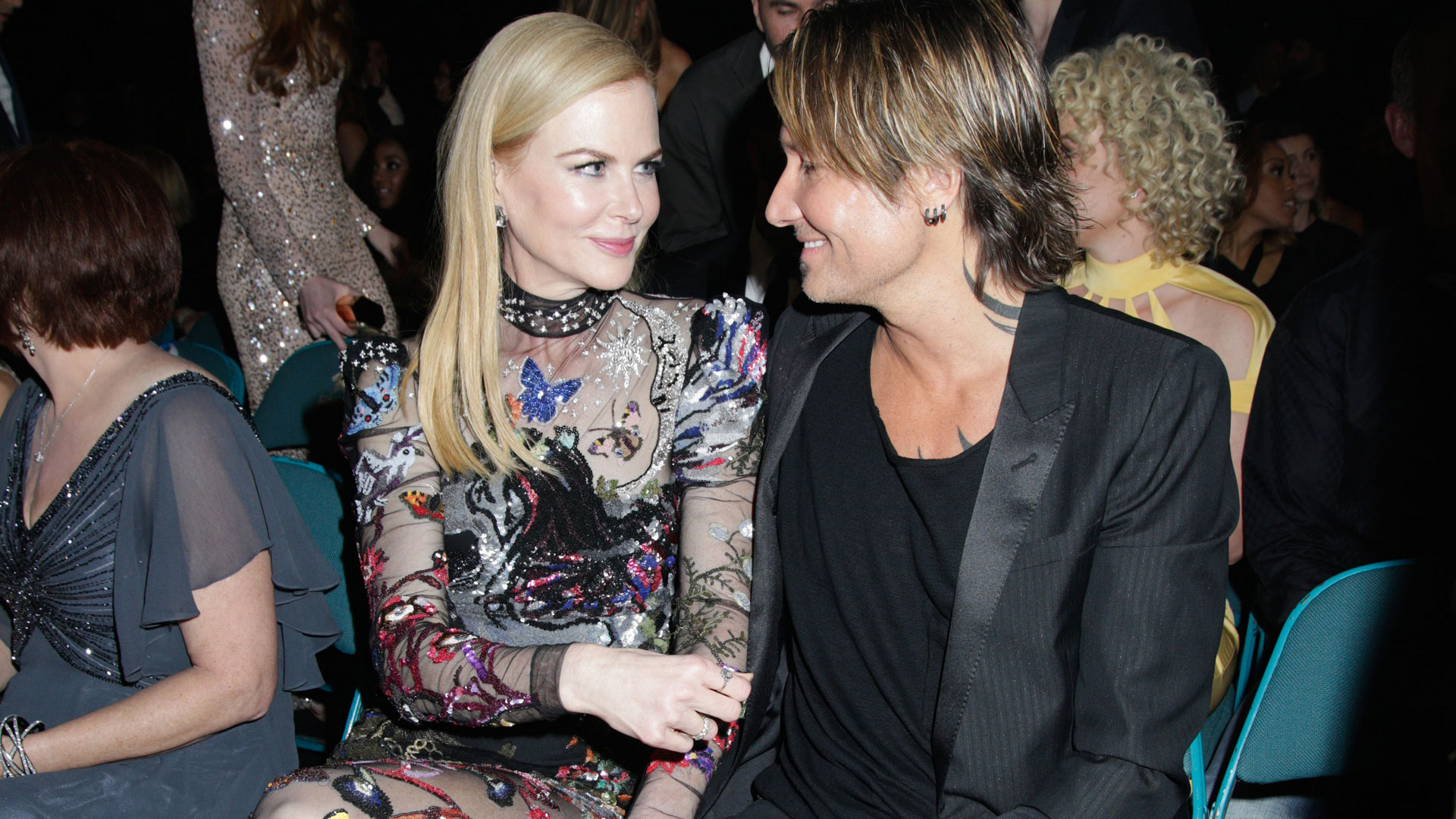 "Actress Nicole Kidman exchanged loving glances with her husband, singer Keith Urban, before he took to the ACM stage to perform ""Wasted Time."""