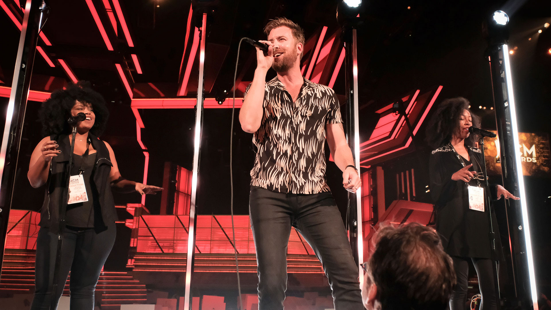 Charles Kelley has a great time while his back-up dancers boogie down behind him.