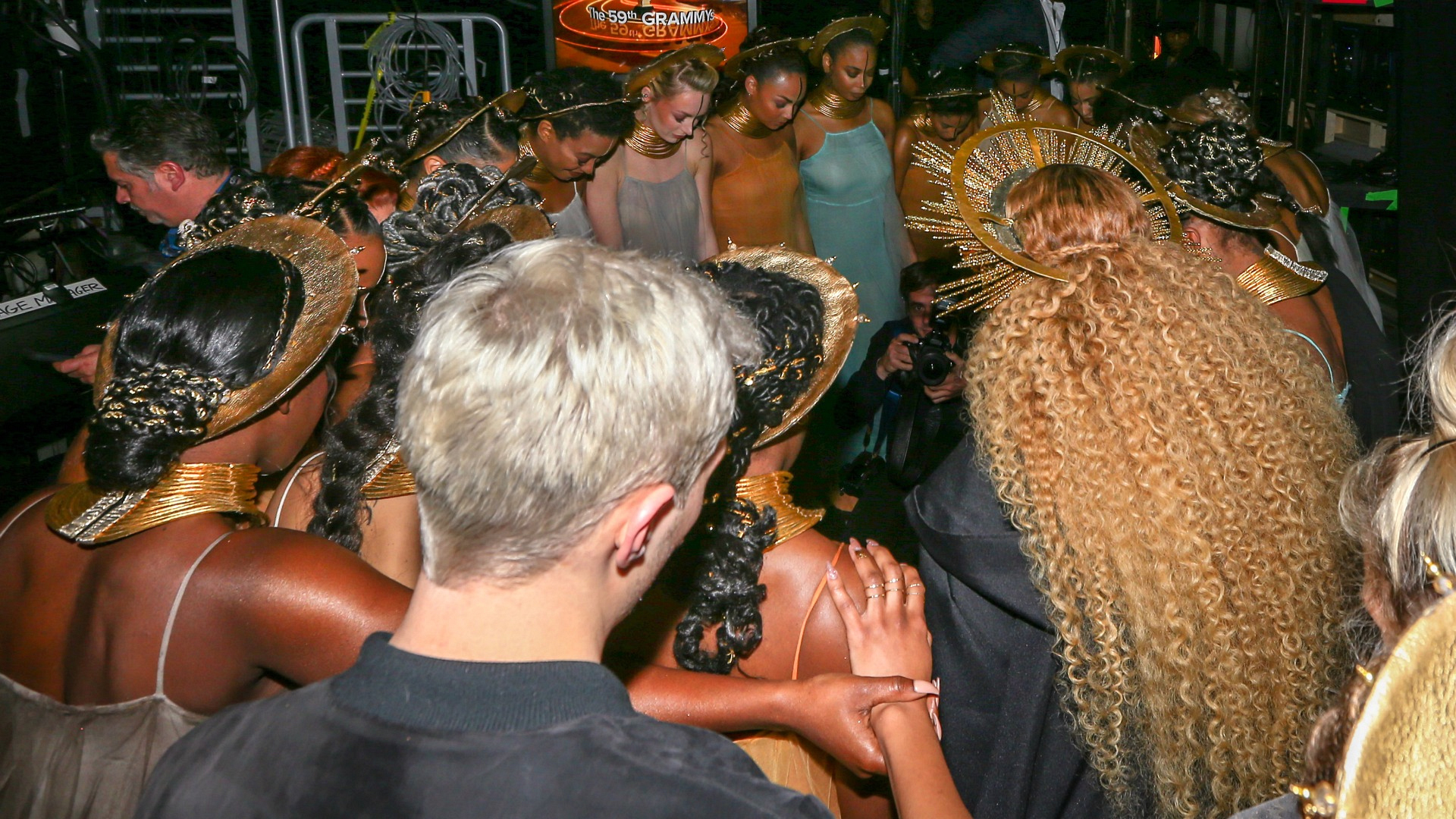 "Beyoncé and her loyal subjects join hands for a pre-show ritual before performing ""Love Drought"" and ""Sandcastles."""