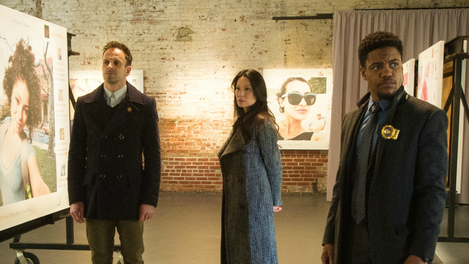 Jonny Lee Miller as Sherlock Holmes, Lucy Liu as Dr. Joan Watson, and Jon Michael Hill as Det. Marcus Bell