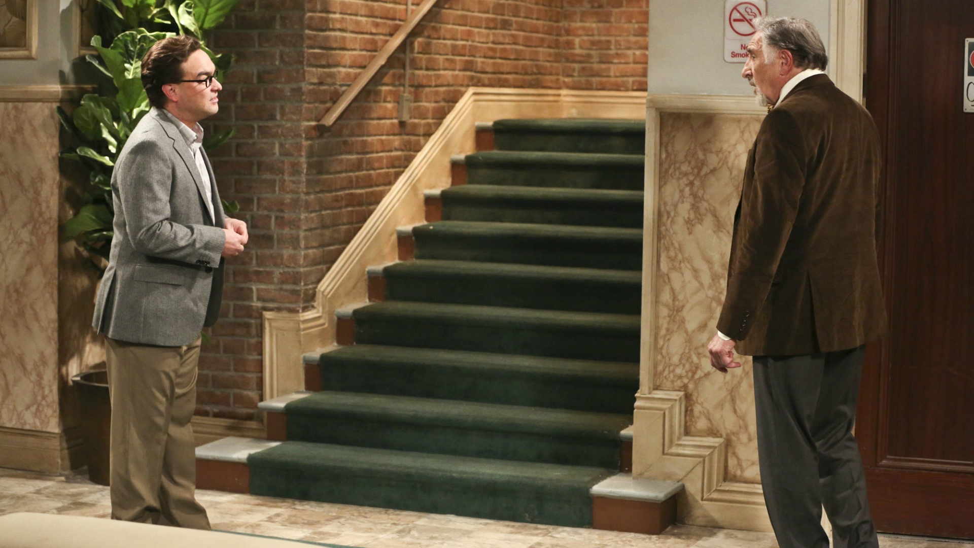 Leonard ushers his father, Alfred, upstairs.