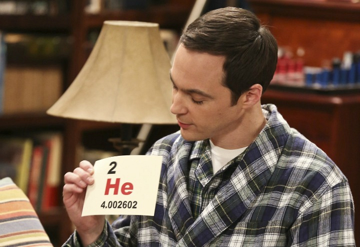Sheldon proudly holds up a helium flashcard.